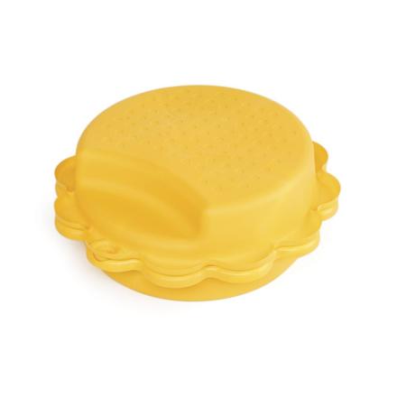 Gele zonnebloem zandbak